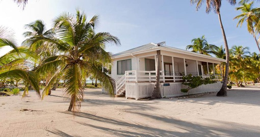 Relax in your own beach cottage on your Belize Tour