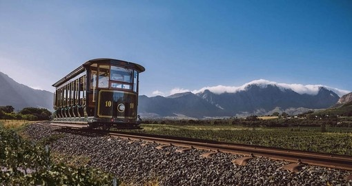 The Franschhoek Wine Tram offers a unique experience on your South Africa Vacation Package