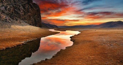 A Mongolian desert sunrise a highlight of many Mongolia tours.