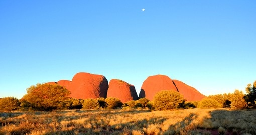 Explore Uluru at sunrise on your next trip to Australia.