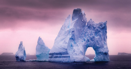 Stunning lighting reflects off mammoth Ice Bergs in Antarctica