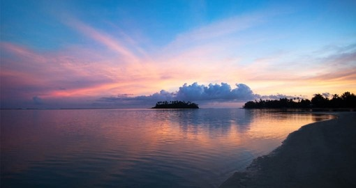 Enjoy Sunset on Muri Beachi on your visit to the Cook Islands