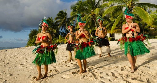 Take in a traditional dinner and show on your Cook Islands vacation