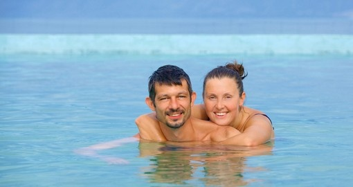 Relaxing couple in a geothermal mineral pool