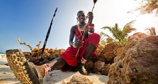 Meet Masai people on the beach during your next trip to Kenya.