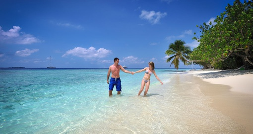 Strolling along the white sand beaches of the Maldives