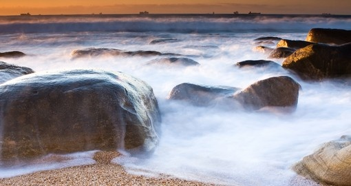 Milky waves and rocky shore beach of Umhlanga near Durban