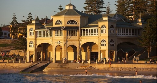 Swimmers relaxing in front of the pavilion at Cottesloe Beach