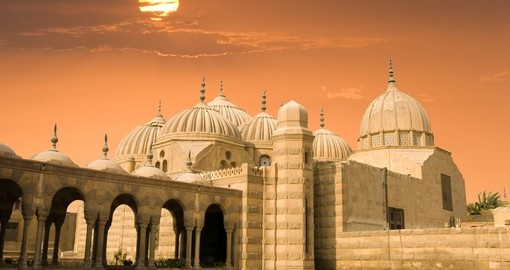 Arabic domes at sunset in Cairo make for a great photo while on your Egypt vacation.