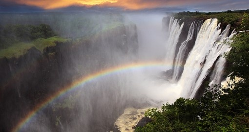 Victoria Falls rainbow sunset