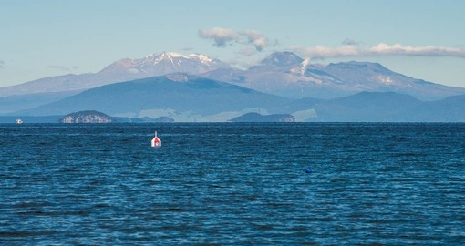 See Tongariro National Park from Lake Taupo on your New Zealand vacation package