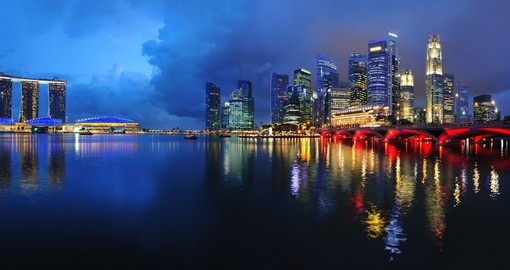 Walk along the beautiful shoreline in Singapore where you can appreciate the skyline at night during your Singapore Vacation