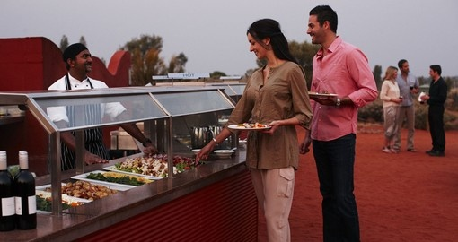 Taste traditional dishes prepared for your group by trained cooks on your Australia Vacation