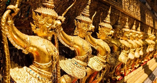 Golden Garuda sculptures at the Royal Palace