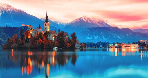 With a picture-perfect church on an islet and a medieval castle clinging to a rocky cliff, Lake Bled is Slovenia's most popular resort