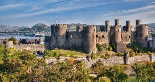 Explore Conwy Castle in Wales and its medieval architecture during your next England vacations.