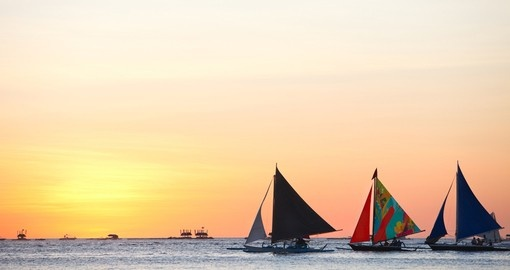 Sailboats against beautiful sunset
