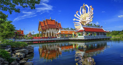Learn about traditional Thai religions at the Wat Plai Laem Temple  on your trip to Thailand