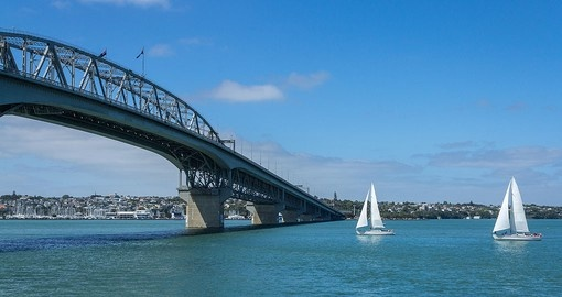 Pass under Harbour Bridge, a major boating area in the region on your New Zealand Vacation
