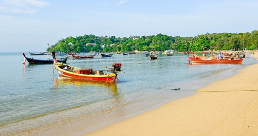 See colourful Long-tail fishing boats on your Thailand vacation