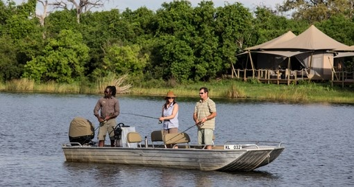 Enjoy fishing breaks on your Botswana safaris.