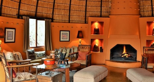 Relax in the lounge at Hoyo Hoyo Safari Lodge during your South Africa vacation.