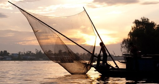 Fishing boat at dusk on the Mekong River