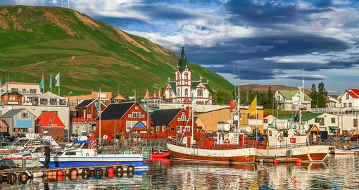 Enjoy the picturesque and colorful houses of Husavik on your Trip to Iceland