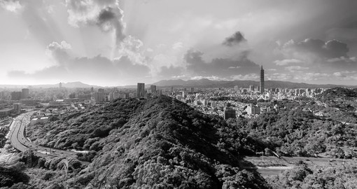 The dramatic Taipei skyline at sunset - a great photo opportunity to experience when booking one of our Taiwan vacations.