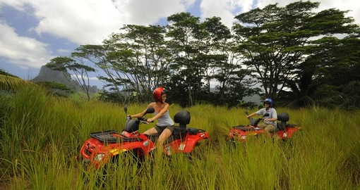 Explore the island on quad runners while on your Tahiti vacation.