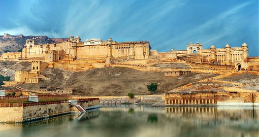 Constructed of red sandstone and marble, The Amber Fort sits on a hill overlooking Jaipur