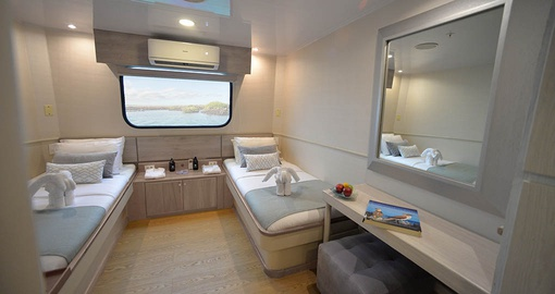 Hang out with a friend on the MC Seaman Twin berth on your Galapagos Tour