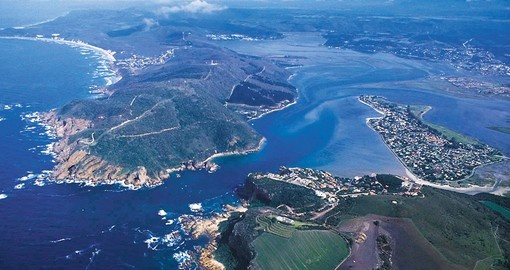 Float along the crystal clear waters of Knysna Lagoon on you South African Vacation
