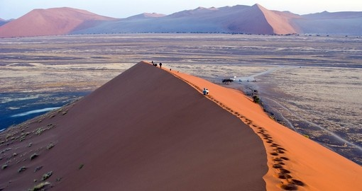 Explore Sossusvlei Dunes and experience its beauty during your next Namibia vacations.