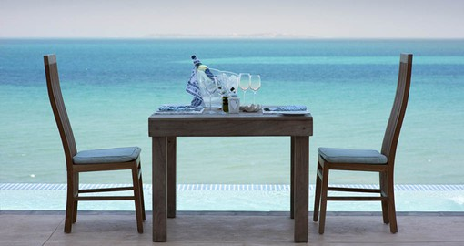 Enjoy a romantic dinner at Villa Santorini on your trip to Mozambique