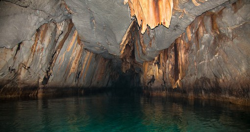 Explore one of the new 7 wonders of the world, Puerto Princesa Cave in the Philippines on your Philippines Vacation