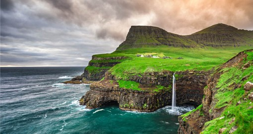 Discover Gasadalur village and its iconic waterfall on your Faroe Island Tour