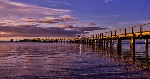 Experience sunset at the jetty at Kingfisher Bay Resort during your next Australia tours.
