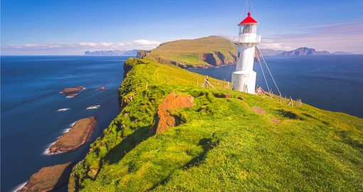 The iconic Lighthouse on Mykines Island is a part of your Faroe Islands trip