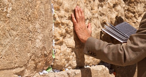 Praying and leaning against the Wailing Wall