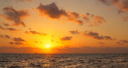 Catch an amazing sunrise on your Belize Tour