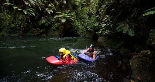 Your New Zealand vacation includes a sledging excursion along the Kaituna River.
