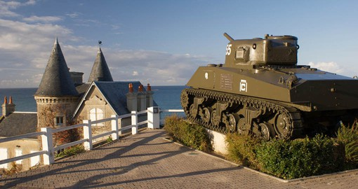 A preserved Sherman tank overlooks the Normandy coast at Arromanches-les-Bains
