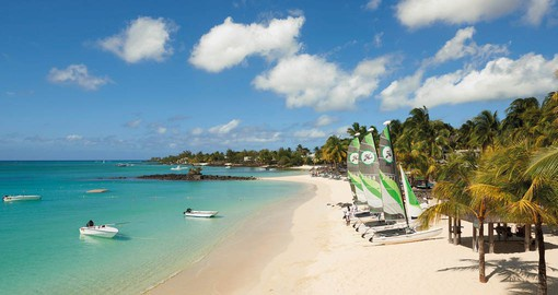 The sheltered white-sand beach of the Royal Palm Beachcomber