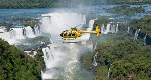 Take a Helicopter over Breathtaking Iguassu Falls on your Brazil Vacation