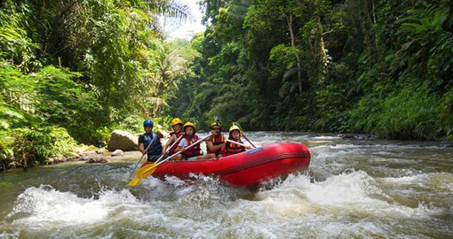 Include a rafting adventure on the Ayung River during your trip to Bali