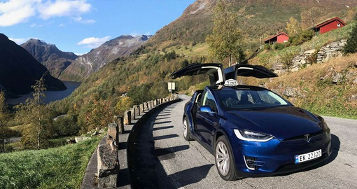 Experience great views from a Tesla Taxi on yoru Norway tour