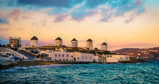 "The island's iconic windmills turning in symphony with the seasonal winds that have branded Mykonos ""island of the winds""."