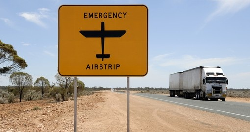 Emergency airstrip sign with road train