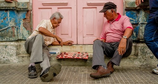 Men playing checkers on the main square of Santa Ana